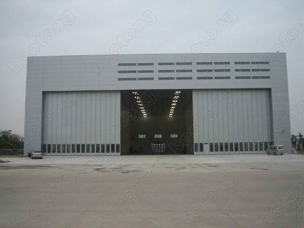 Hangar door aircraft docking system sliding