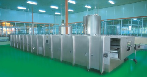 Continuous spray cooling machine
